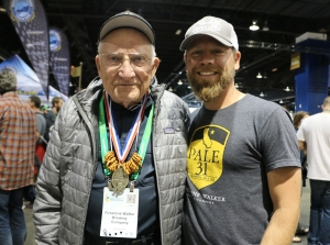 Brewmaster Matt Brynildson of Firestone Walker lets his grandfather wear the medal around the hall..