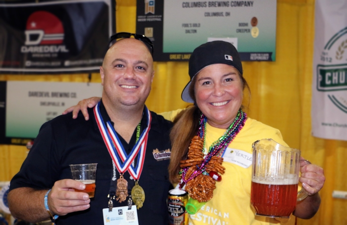 Tony Corder is congratulated by a volunteer pourer for the pair of Columbus Brewing Co. medals