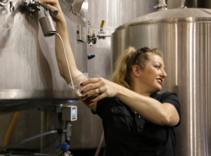 Brewer Cat Wiest leads a tour and offers fermenter samples